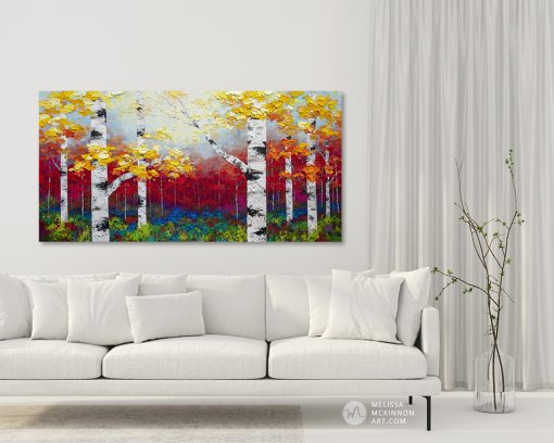 Colourful contemporary painting of birch trees and aspen trees in autumn forest by contemporary artist abstract landscape painter Melissa McKinnon painted with palette knife and impasto texture displayed in modern white livingroom.