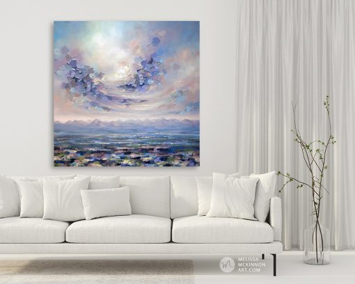 Large art print on canvas of mountain landscape and colourful cloudy sky hanging in a modern home title Beneath the Surface