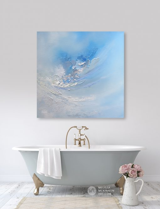 Abstract art print on canvas of cloudy blue sky hanging in modern home by artist Melissa McKinnon title Carried Away
