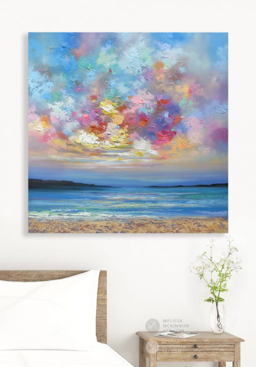 Affordable wall art print of ocean beach seascape and colorful sunset sky by Melissa McKinnon displayed in modern bedroom title Colourbration