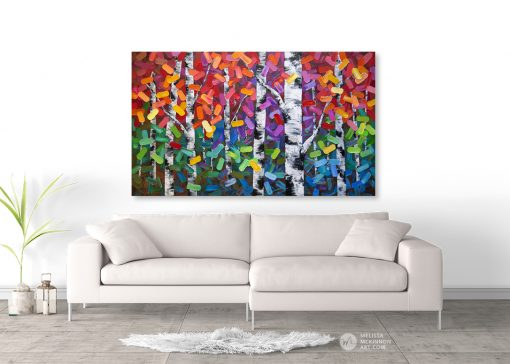 Abstract art print on canvas of aspen and birch trees in autumn forest by artist Melissa McKinnon hanging above sofa title Eye Candy