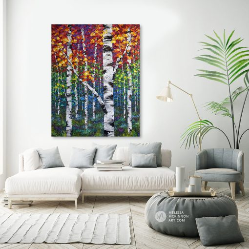 Large canvas art print of autumn birch and aspen trees by artist Melissa McKinnon hanging in living room title Festival of Colour