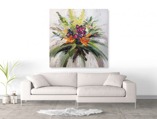 Flower art print of pink orange yellow floral arrangement hanging above couch by artist Melissa McKinnon title Gratitude and Joy