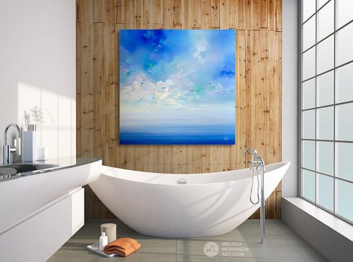 Abstract sky art print on canvas of cloudy sky over blue ocean seascape by artist Melissa McKinnon hanging in spa bathroom title New Horizons