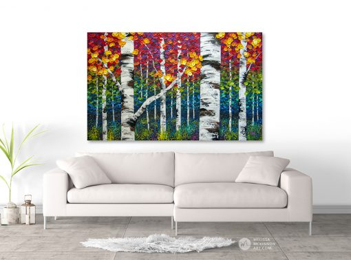 Fine art print for sale of aspen trees and birch trees in autumn forest by artist Melissa McKinnon hanging above sofa title Not An Ordinary Day