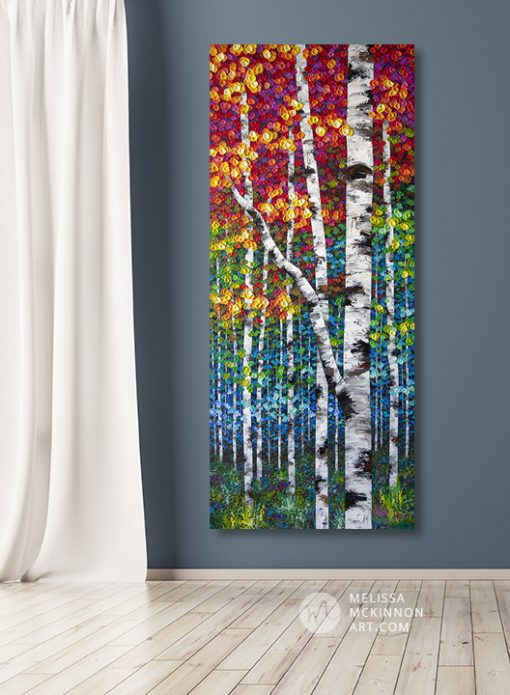 Large wall art print on canvas of colorful autumn aspen and birch trees by artist Melissa McKinnon hanging in modern home title Rise Above