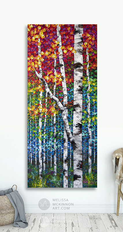 Large wall art print on canvas of colorful autumn aspen and birch trees by artist Melissa McKinnon hanging in modern living room title Rise Above