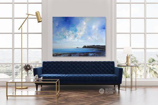 Landscape art print on canvas of blue ocean seascape and cloudy sunrise sky by Melissa McKinnon displayed in modern home title Where I Need To Be