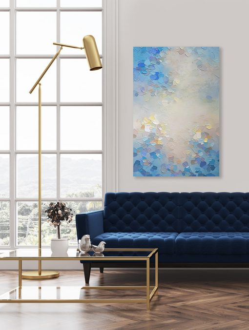 Pale blue abstract painting of clouds and sky hanging in a modern living room Giclee art print on canvas by contemporary abstract artist Melissa McKinnon painted with palette knife and impasto texture - Morning Glow III