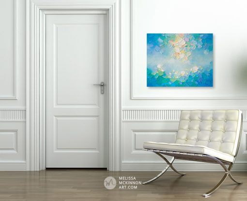 Original abstract painting of blue sky and white clouds by Canadian abstract painter Melissa McKinnon hanging in modern home interior.