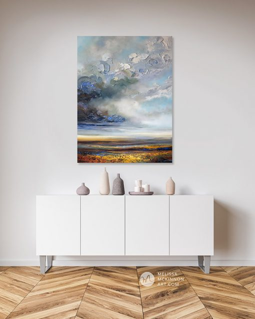 Original painting of moody abstract landscape with stormy cloudy sky and prairie field by Canadian Artist Melissa McKinnon hanging in modern home interior Title Hope On the Horizon