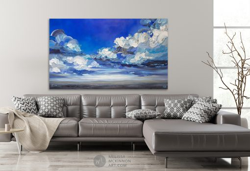 """Dramatic landscape painting of cloudy stormy sky and ocean seascape by contemporary Canadian Artist Melissa McKinnon created with vibrant colour and thick impasto texture displayed in modern home interior """"In My Wake"""""""