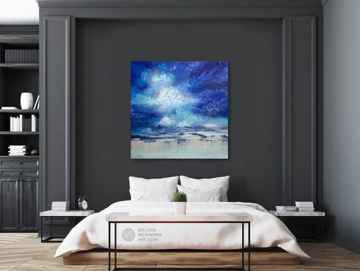 """Large abstract landscape painting with dramatic sky blue sky and stormy clouds by Contemporary Canadian Artist Melissa McKinnon displayed in modern bedroom interior """"Seeking Light"""""""